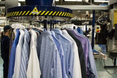 shirts hanging on conveyor