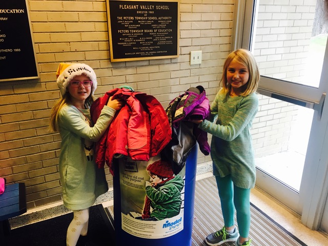 Pleasant Valley Elementary School students filling up the Model Coat donation bins in an effort to help other kids stay warm this winter